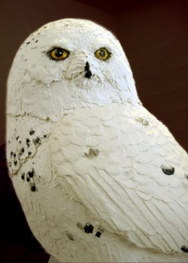 Snowy owl made with paper mache clay.