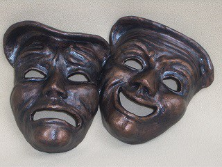 theater masks with bronze coating over paper mache clay