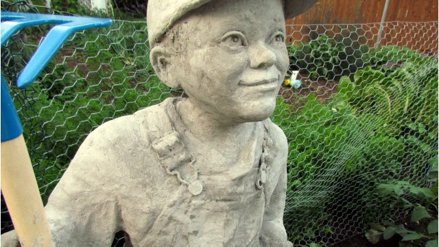 Cement Sculpture of Little Farmer