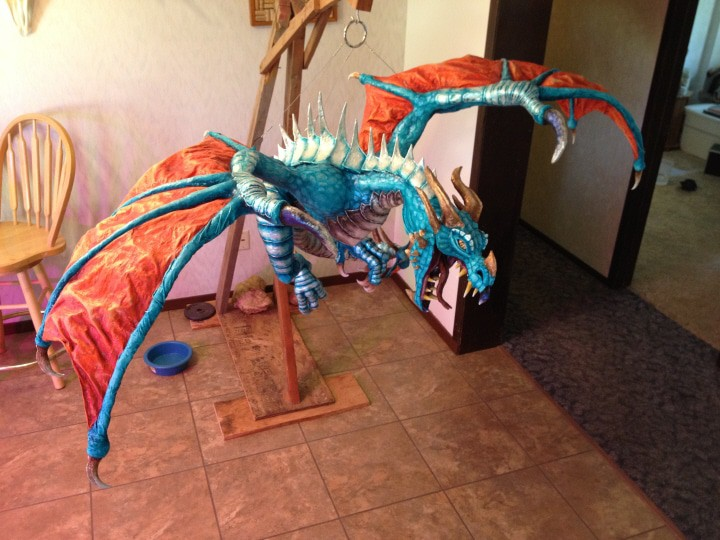 Paper Mache dragon, on it's stand.