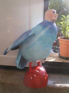 Paianting the paper mache bird man sculpture