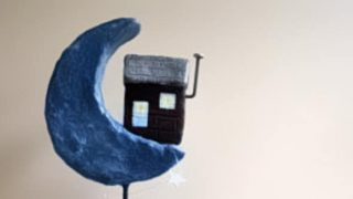 Make a paper mache house sculpture