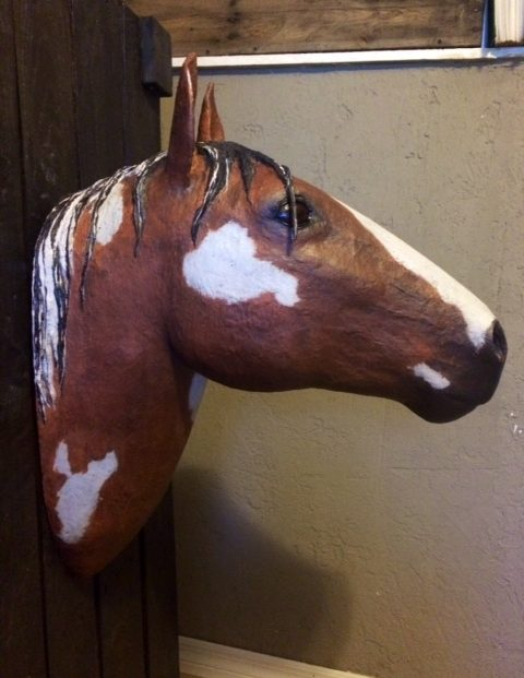 Painting the paper mache horse head, other side.