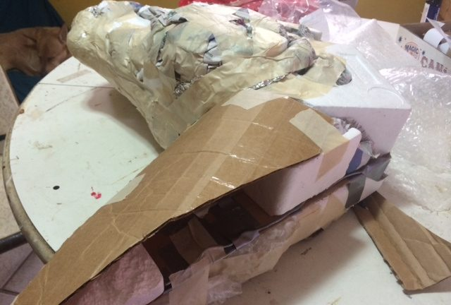 Adding the padding to the paper mache horse armature.