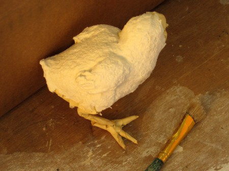 Adding paper mache clay to the baby chick