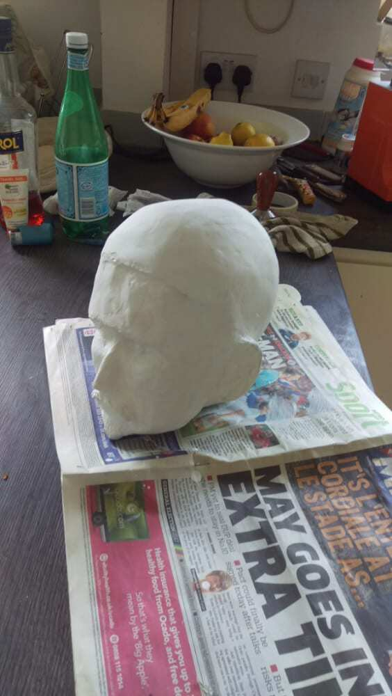 Using Polyfilla over paper mache to smooth out details.