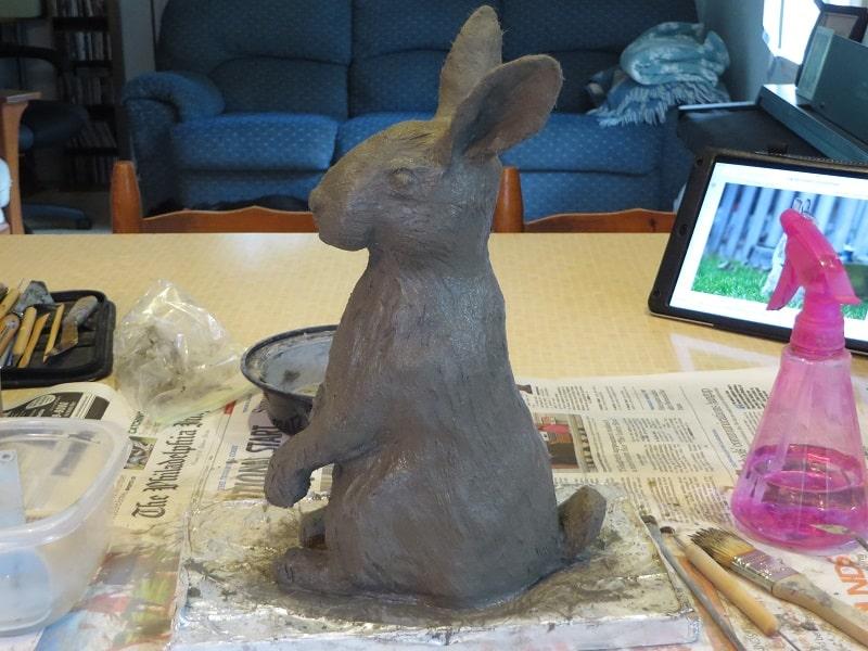 Adding details to rabbit sculpture