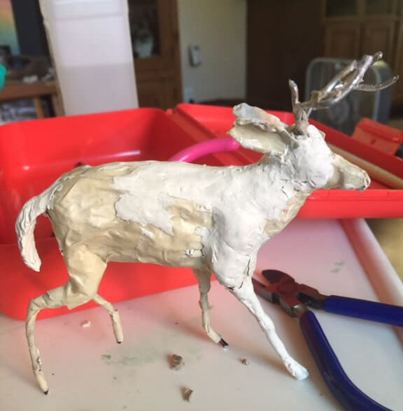 Paper mache clay, and epoxy on antlers.