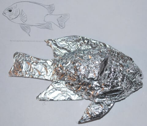 Photo 3: The fish armature covered with foil, held on with hot glue.