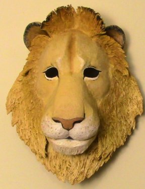 Lion wall mask made with paper mache.