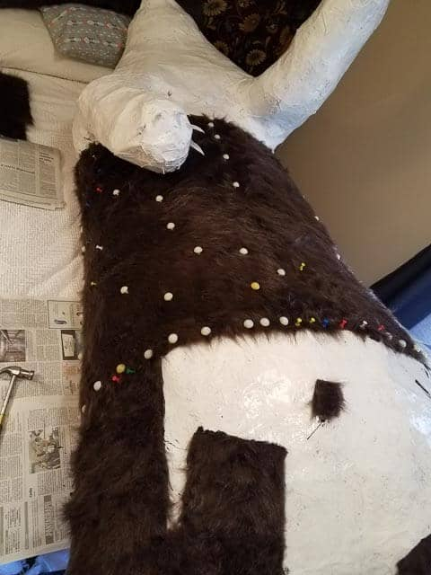 Adding more fur to bear sculpture