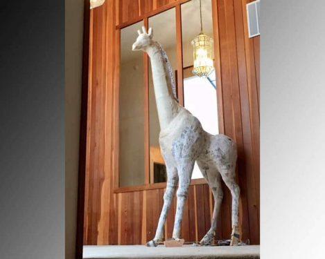 life-sized paper mache giraffe