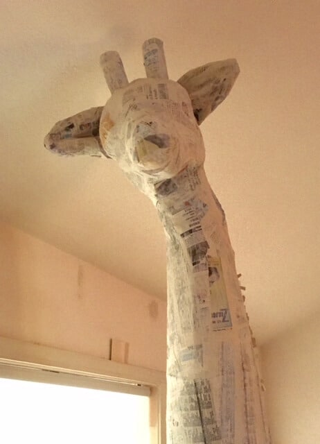 Giraffe sculpture with paper mache