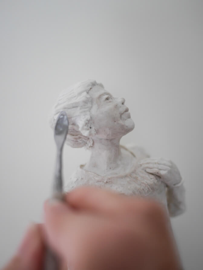 Regency hairdo on paper mache clay sculpture