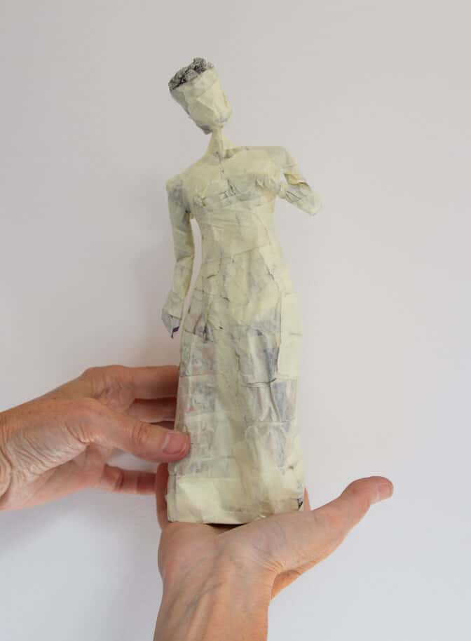 Paper mache figure armature with arms added