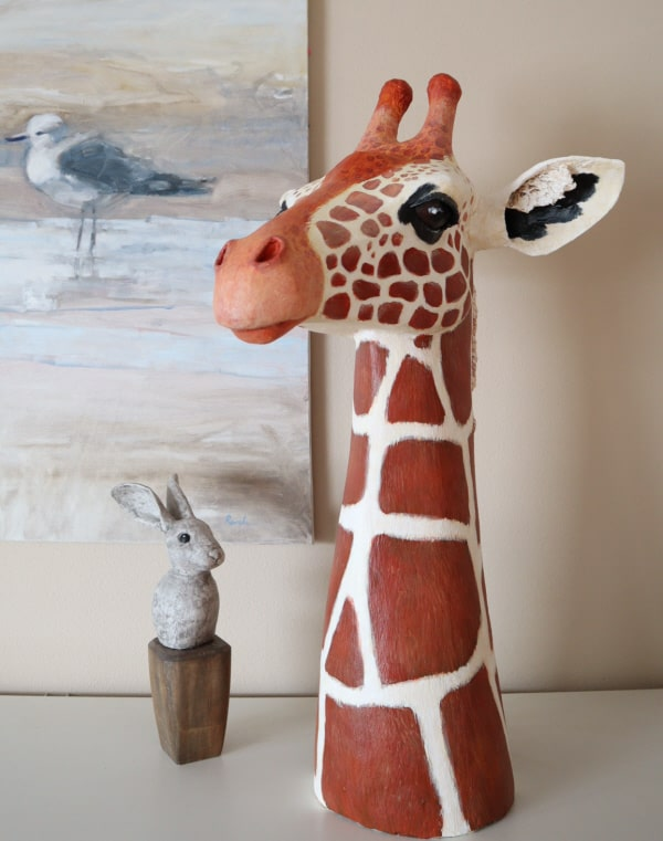 Air dry clay hanging out with the giraffe sculpture.