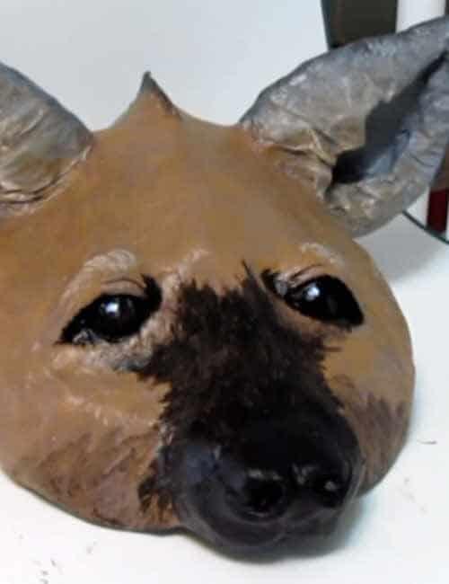 Paper mache hyena mask pattern.