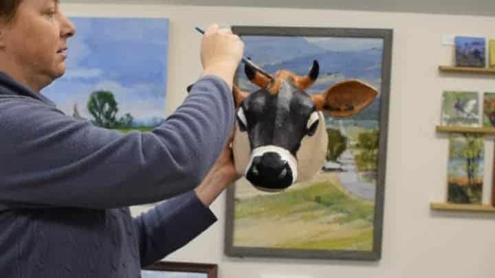 Putting dark orange on the jersey cow's forehead.