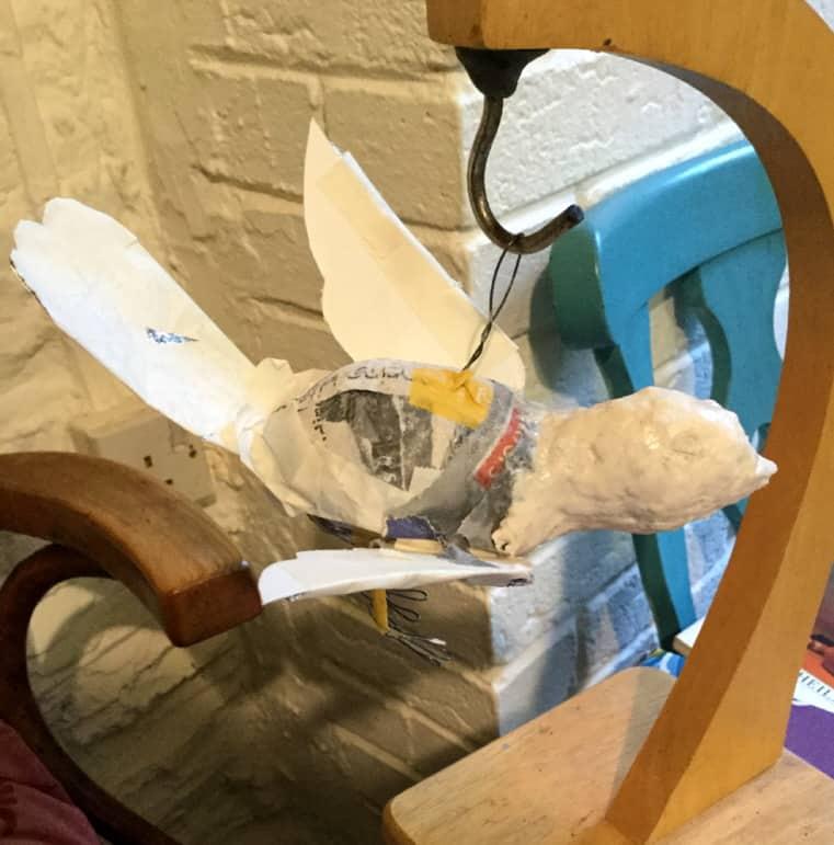 Hanging the bluebird sculpture.
