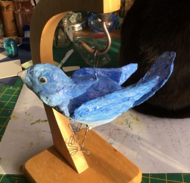 The painted bluebird sculpture.