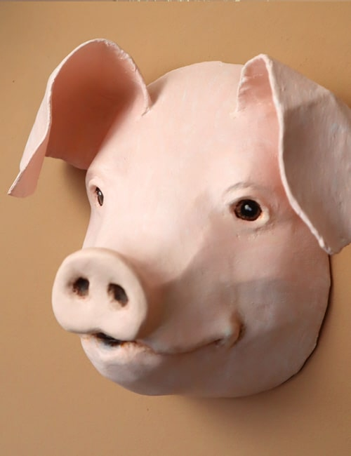 Paper mache pig wall sculpture