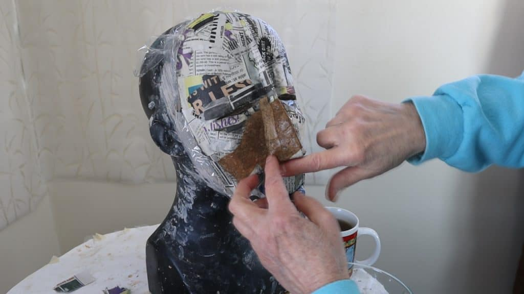 Add paper mache to the African Mask