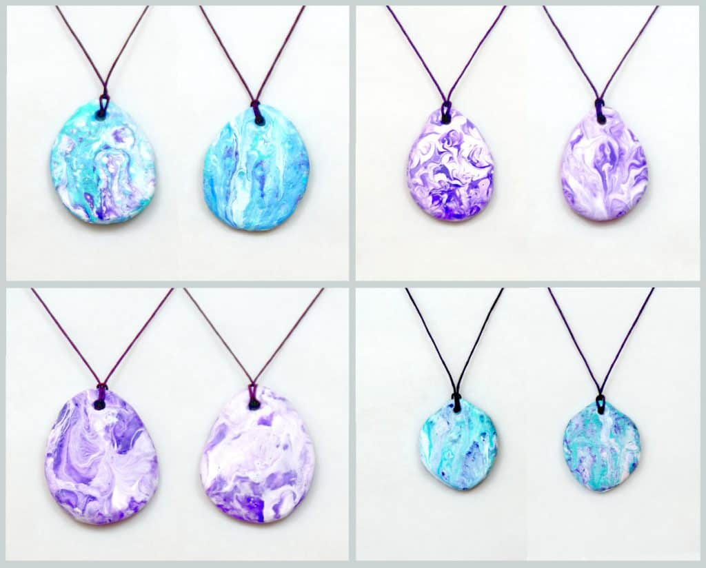 Acrylic pour used for paper mache clay pendants.