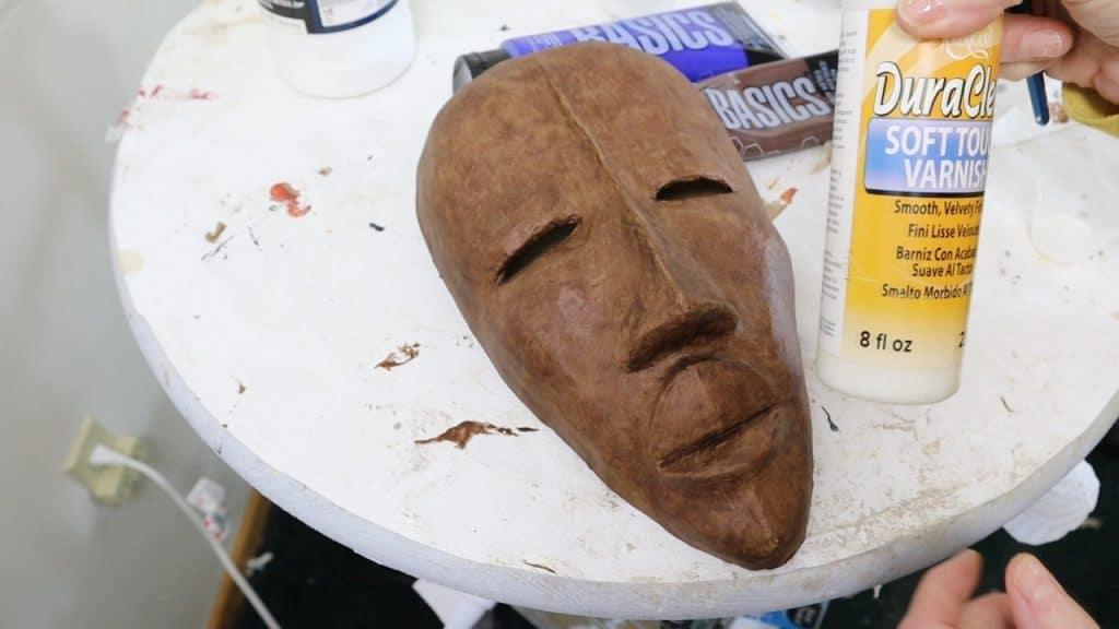 Matte varnish over the African mask.