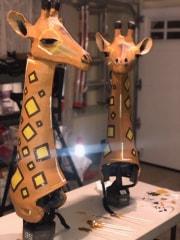 Giraffe helmet-style masks by Victoria Flick