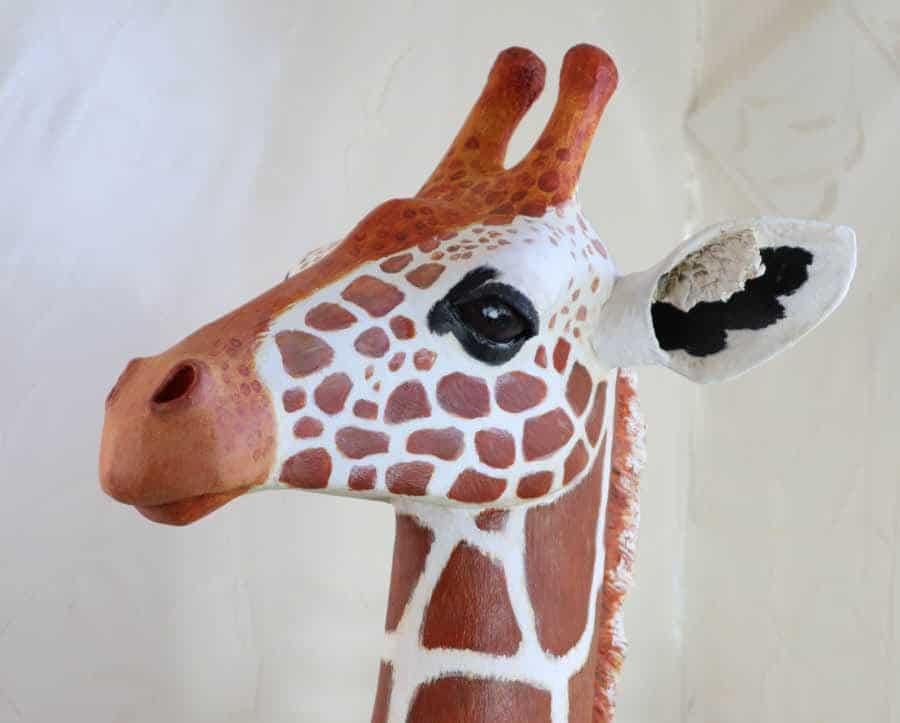Paper mache clay giraffe sculpture, painted.