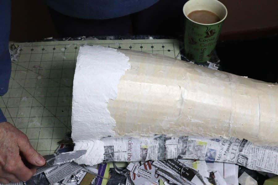 Adding a thin layer of paper mache clay to the giraffe armature.