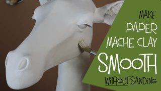 Add joint compound to paper mache clay to make it smooth