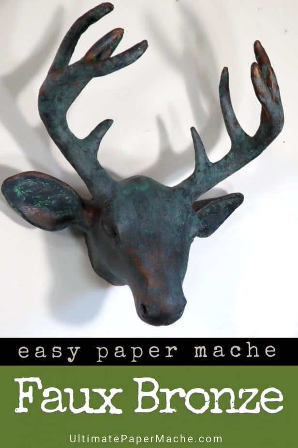 Faux bronze paper mache deer head
