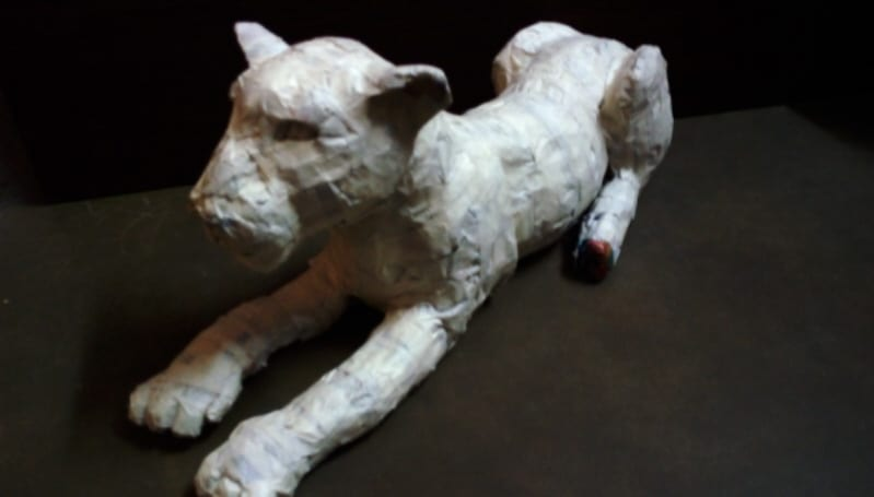The paper mache jaguar with limbs attached.