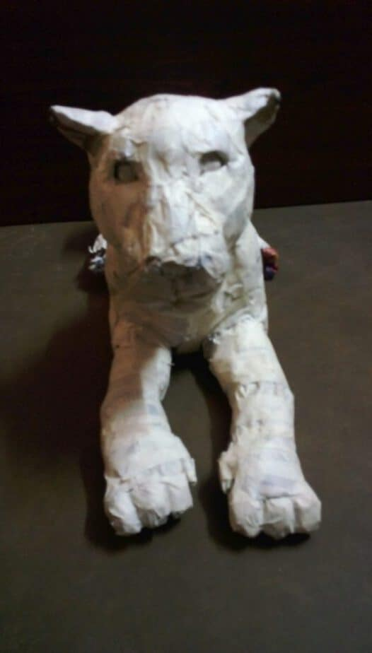 Creating the face shapes on the paper mache jaguar.