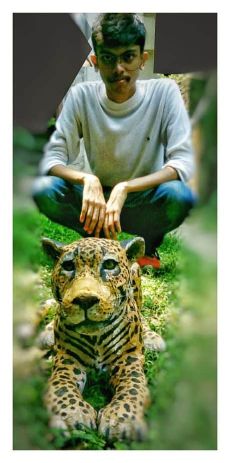 Sattik with his finished paper mache jaguar.