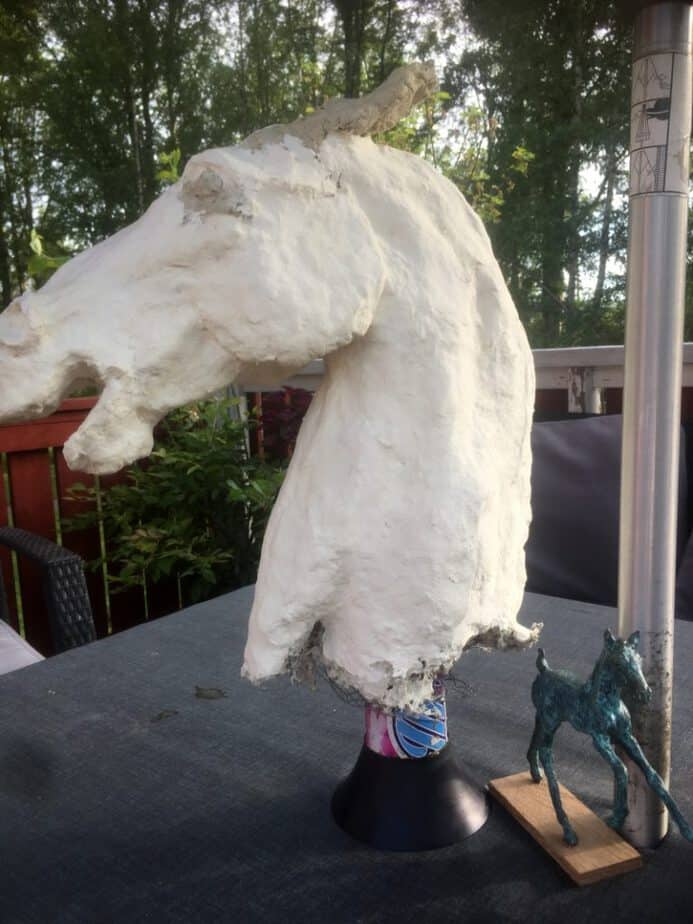Ppaer mache clay applied over wire mesh on horse head sculpture