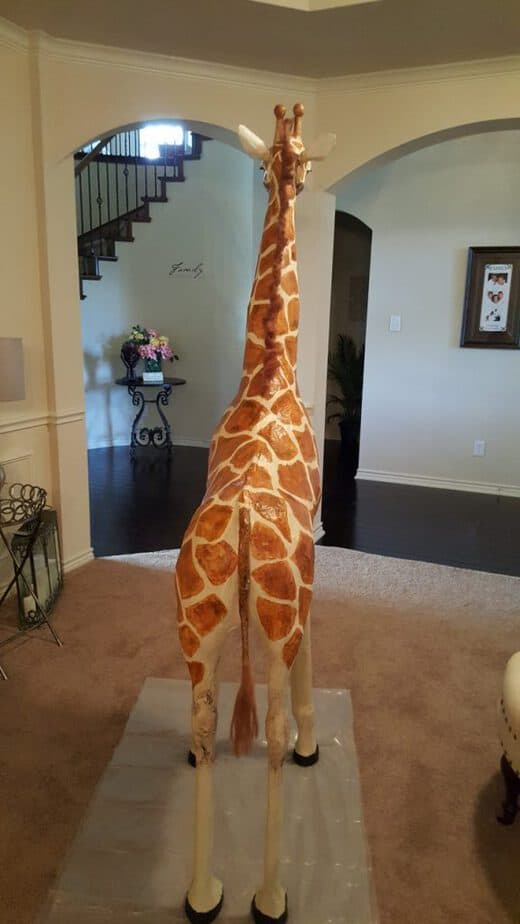 Back view of the large paper mache giraffe.