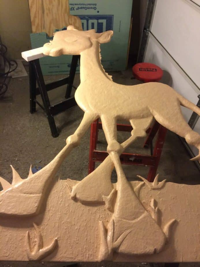 Painting the base coat on the giraffe.