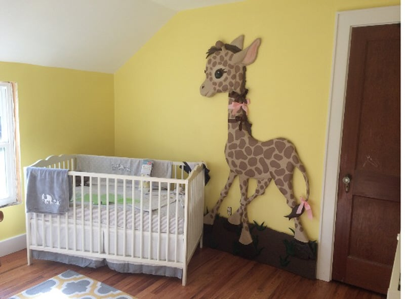 Finished giraffe wall sculpture in baby's nursery.
