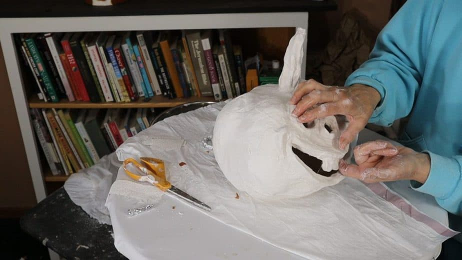 Clean up the edges on your plaster cloth pumpkin.