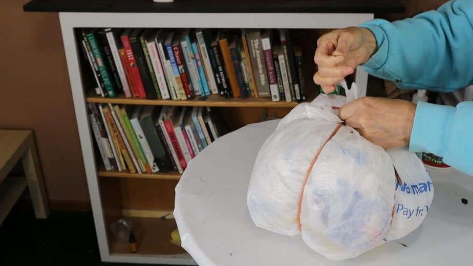 Make a pumpkin shape with plastic bags.