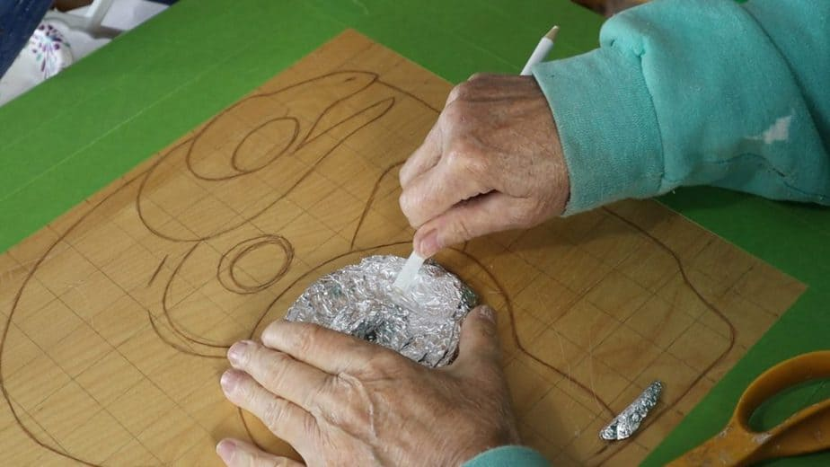 Use crumpled foil and hot glue for your form.