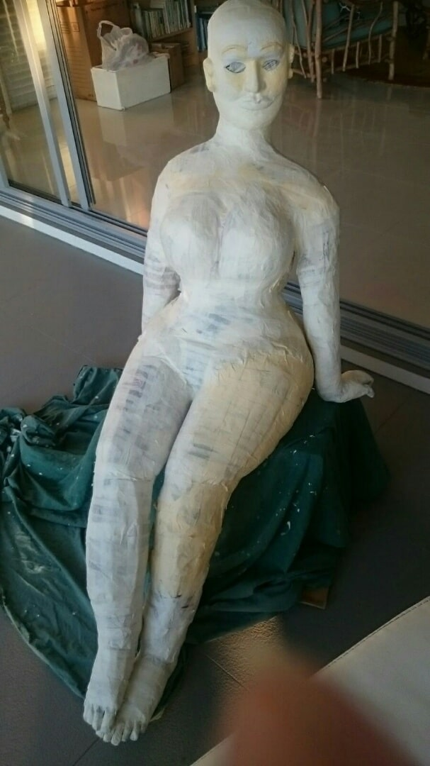 Filling in the forms on the figure sculpture