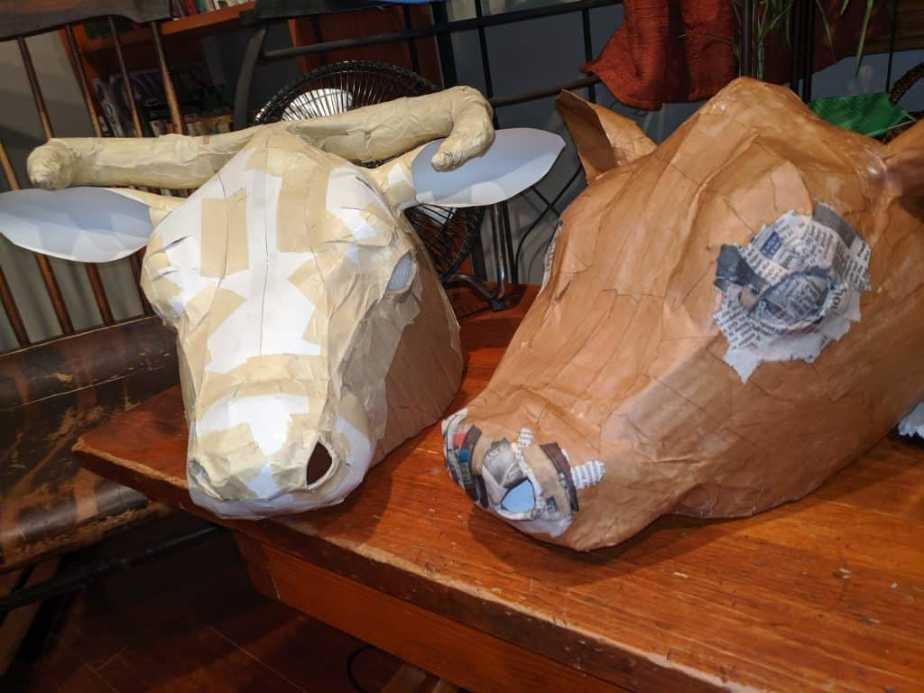cow and bull masks covered with paper mache