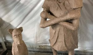 Girl and dog made with paper mache