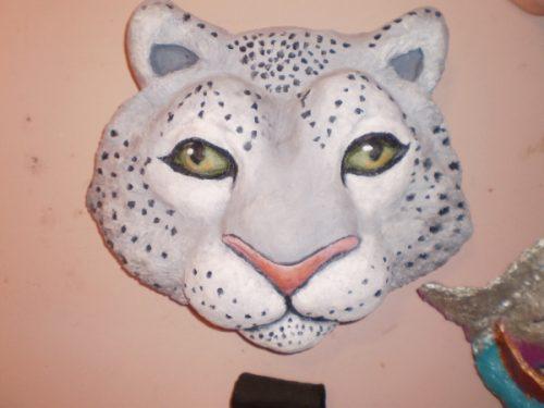 Paper mache snow leopard mask