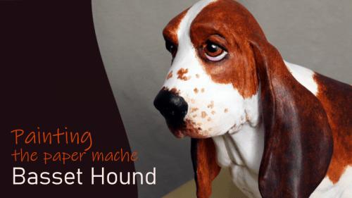 Painting the paper mache basset hound