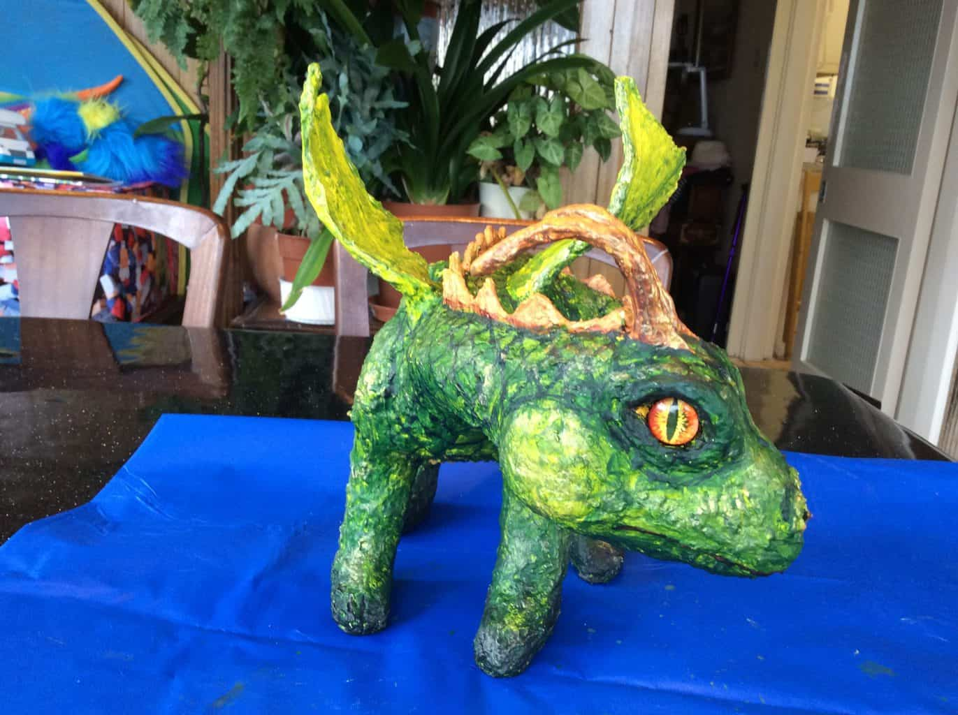 paper mache dragon face with glass eyes