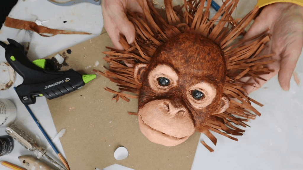 Baby orangutan face made with paper mache
